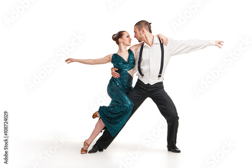 Fotografía  professional artists dancing over white