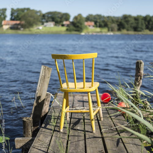 Yellow chair on jetty