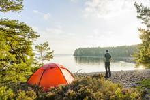 Young Man Camping By Lake