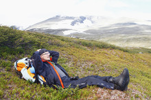Man Lying On Hill And Looking ...