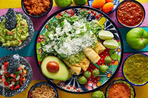 Photo Stands Ready meals Green enchiladas Mexican food with guacamole