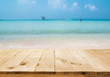 image of wooden table in front of Summer sea in Thailand