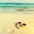 retro slippers on tropical beach in summer - vintage color tone effect