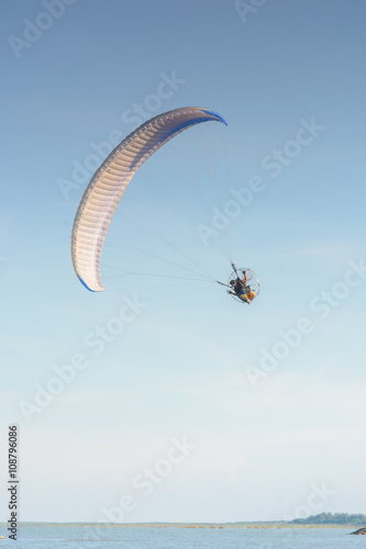Poster Luchtsport Paramotor on the sky in the evening:Close up,select focus with s