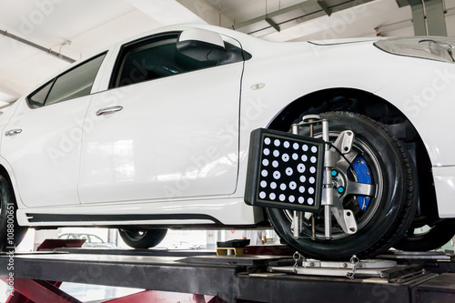 Photo Suspension adjustment and Automobile wheel alignment work being installed with c