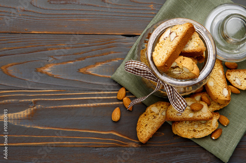 Slika na platnu Italian cantuccini cookie with almond filling on wooden background