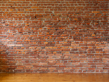 Room With Red Brick Walls And Wooden Flooring Of Boards