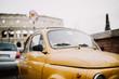 Close-up of an old yellow car