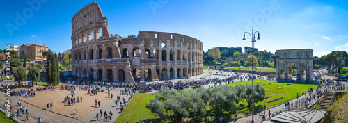 Photo Stands Rome Colosseum in Rome, Italy
