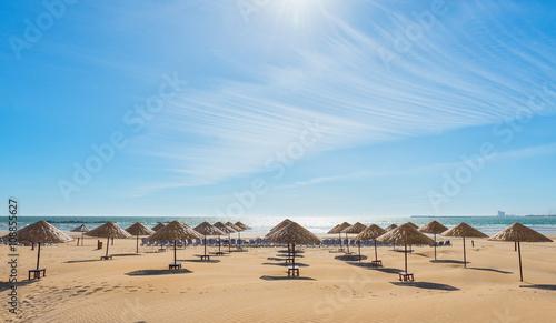 Poster Maroc Beach umbrellas on the the beautiful empty beach.