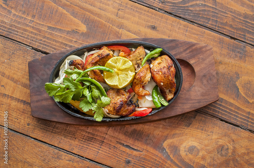 Deurstickers Klaar gerecht Food grilled chicken pieces on a dish