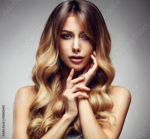 obraz dibond Beautiful blonde woman with long, healthy , straight and shiny hair.