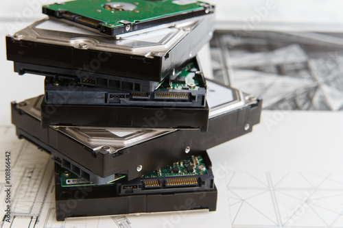 Fotografía  pile of  hard drives at white background