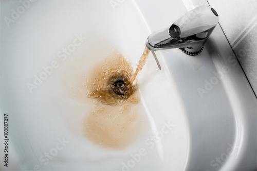 Fotografie, Obraz  Dirty brown water running into a sink