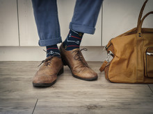 Fashion Man Legs In Indigo Navy Blue Pants, Navy Anchor Socks, Leather Shoes And Leather Tote Bag ( Vintage Tone Color )