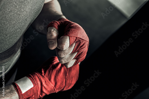 Closeup male hand of boxer with red boxing bandages Tableau sur Toile