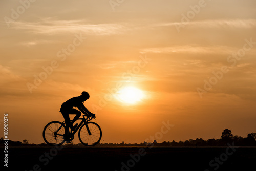 Silhouette of cycling on sunset background Poster