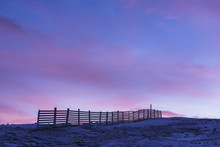 Winter Landscape With Fence At Dawn