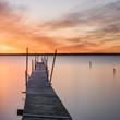 Wooden pier and lake at sunset