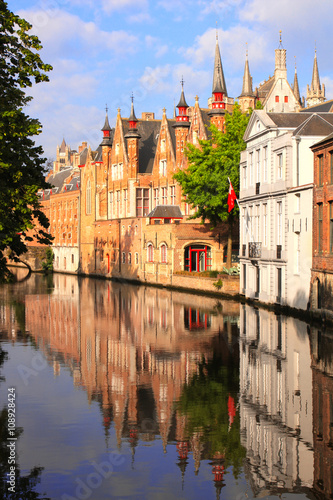 Poster Brugge Medieval buildings along a canal in Bruges, Belgium