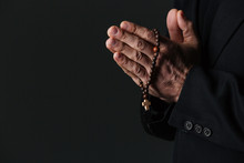 Hands Of Priest Holding Rosary...