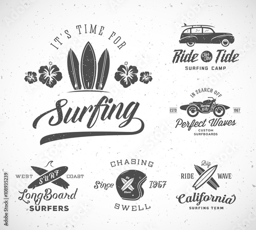 Photo  Vector Retro Style Surfing Labels, Logo Templates or T-shirt Graphic Design Featuring Surfboards, Surf Woodie Car, Motorcycle Silhouette, Helmet and Flowers