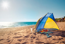 Beach Scene With A Beach Tent