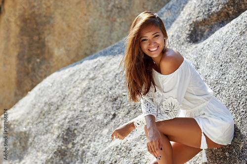 Obraz na płótnie Cute pretty tanned slim girl in white dress on the beach