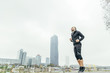 Austria, Vienna, jogger training on Danube Island in front of Donau City