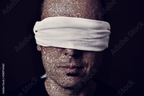 young man with a blindfold in his eyes Canvas Print