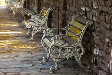 Many Park Benches On Shaded Sl...
