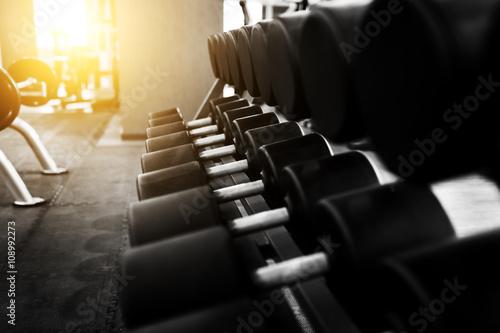 Foto op Plexiglas Fitness Metal dumbbells lying on gym fitness club