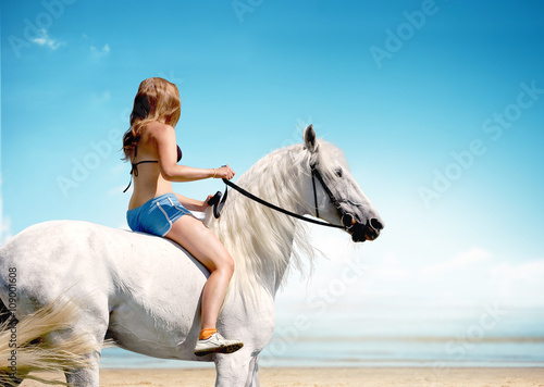 Poster Artist KB girl riding a horse on the beach