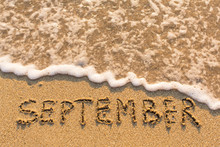 September - Word Drawn On The Sand Beach With The Soft Wave. Months Series Of 12 Pictures.