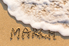 March - Word Drawn On The Sand...