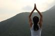 young yoga woman at spring mountain peak