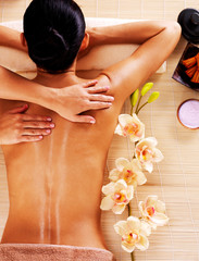 Fototapeta Adult woman in spa salon having body massage.