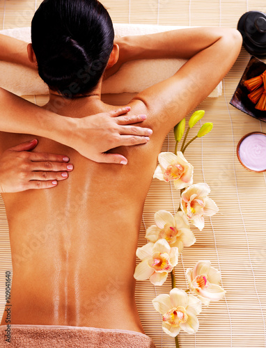 Adult woman in spa salon having body massage. - 109041640