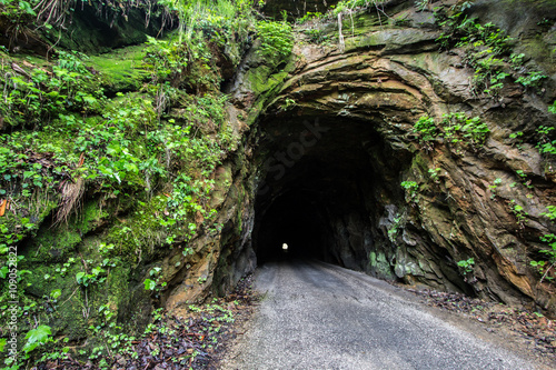 The Haunted Nada Tunnel. The 900 foot Nada Tunnel in the Red River Gorge of Kentucky. Open to traffic, the harrowing one way tunnel is a thoroughfare for a two way traffic.