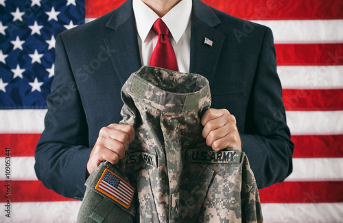 Politician: Holding A Military Uniform Jacket