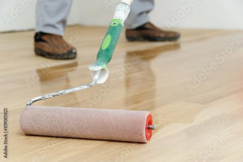 Obraz Lacquering wood floors. - fototapety do salonu