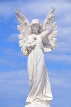 White Angel Grave Yard Statue With Blue Sky