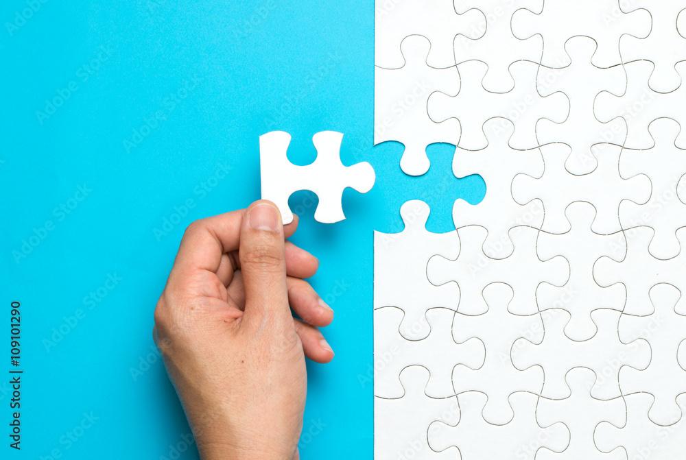 Fototapeta White jigsaw puzzle