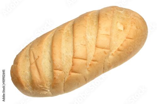 Fotografie, Obraz  Long loaf of white loaf on a white background