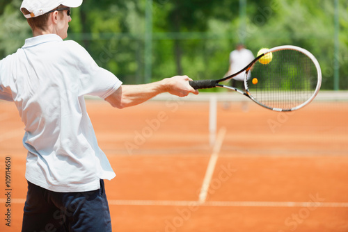 Friends playing tennis, forehand shot Poster