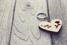 Heart Keychain On Wood Table