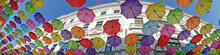 Panorama And Background With Colored Umbrellas On One Street In Timisoara, Romania