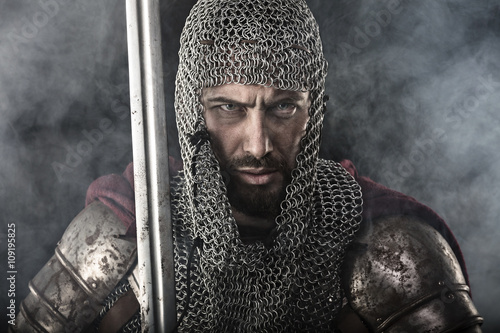 Photo  Medieval Warrior with chain mail armour and sword