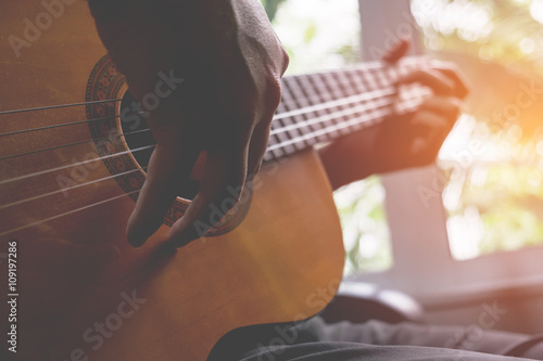 Acoustic guitar guitarist playing. Musical instrument with perfo Canvas Print