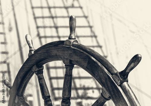 Keuken foto achterwand Schip Steering wheel of old sailing vessel in retro style.